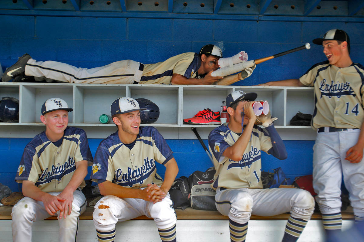 Lafayette baseball players joke around trying to pass the time during a weather delay during Wednesday's Conference 25 tournament semifinals against New Kent.