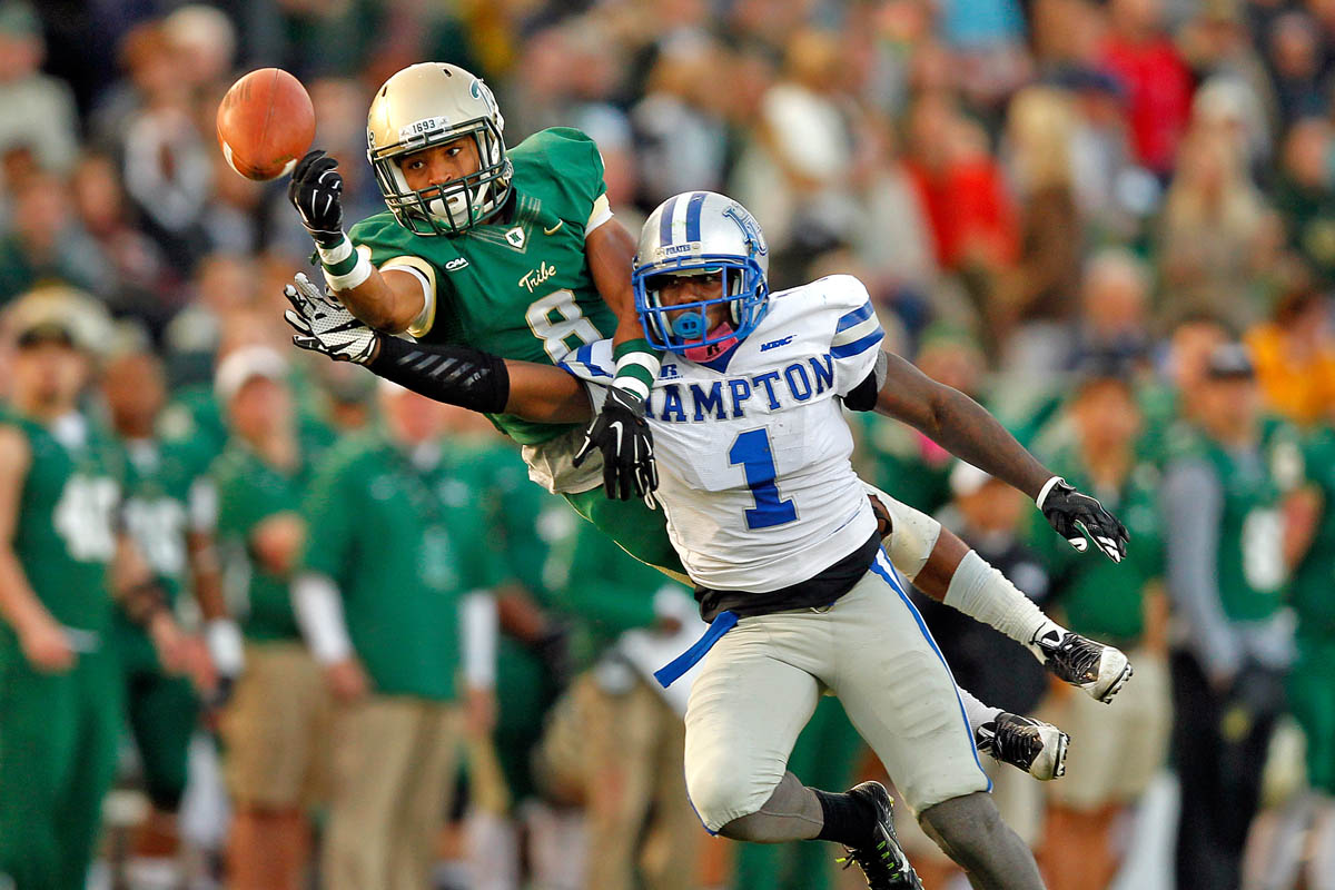 William and Mary's Trey Reed, left, disrupts a pass intended for Hampton University's Rayshad Riddick during Saturday's game at Zable Stadium October 24, 2015.