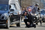 Newport News Police Chief Steve Drew falls to one knee and touches the hearse carrying officer Katherine Thyne outside of the Newport News Police Department South Precinct during a procession Saturday afternoon January 25, 2020. Officer Thyne died Thursday night after being dragged by the car of a man who she and another officer were questioning. On Saturday, the Newport News Police Department transported officer Katherine Thyne from the Medical Examiner's Office in Norfolk to Altmeyer Funeral Home in Newport News.