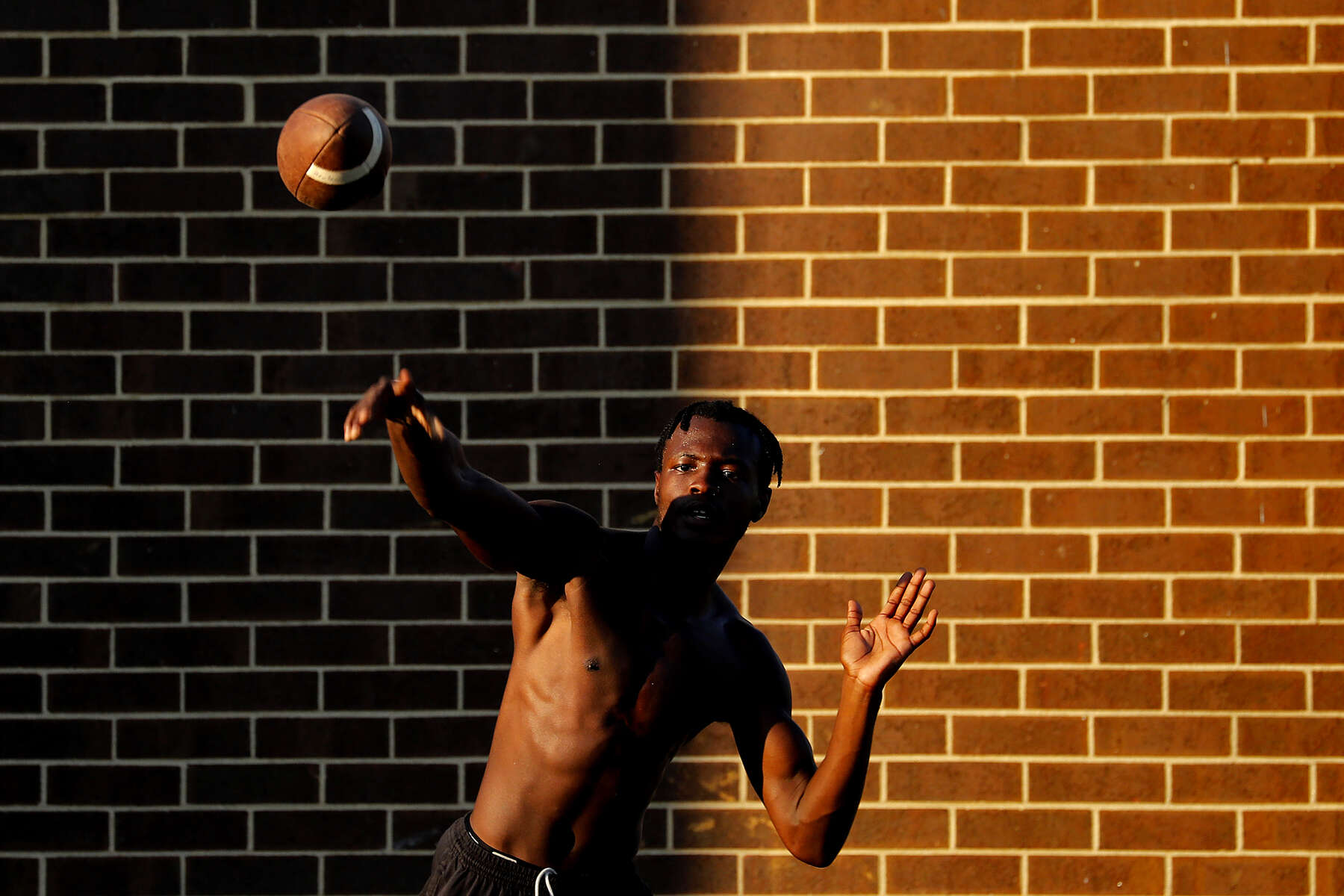 Bruton's Mikal Whack throws the ball during a water break of Thursday evening's football practice July 25, 2019. Bruton, a school of 600, always struggled with small football participation numbers and in a 2018 lost two of its best linemen to injury.  That left the Panthers with 15 players, half of them with no varsity experience. The team cut their schedule in half and were outscored 262-14 during their winless season. In 2019 the team will return to playing a full 10-game season.