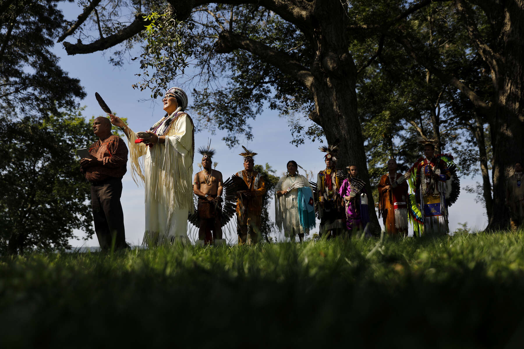 """Chief G. Anne Richardson of the Rappahannock Tribe performs a ceremonial blessing before the start of Wednesday's event celebrating seven Virginia Tribes who recently received federal recognition October 3, 2018. """"This is liberty for us. This is justice for us,"""" Richardson said. """"And we're finally seeing the promises that are inherent in our constitution that we've been left out of all these years."""""""
