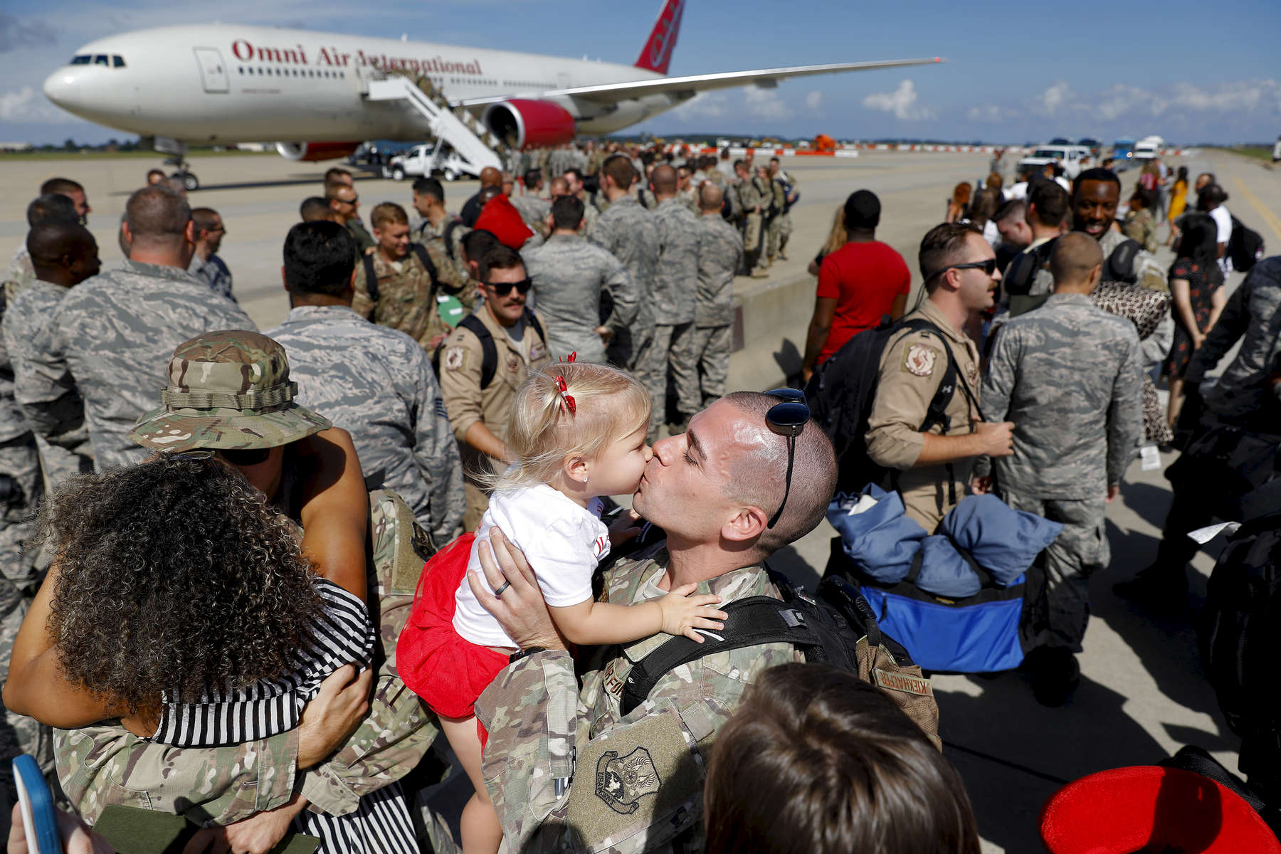 Tech Sgt. Grant Kiekhaefer kisses his two-year-old daughter Kori Kiekhaefer during a homecoming ceremony at Langley Air Force Base Tuesday afternoon October 9, 2018. One hundred eighty-seven members of the 1st Fighter Wing returned home after a six month deployment in the Middle East.