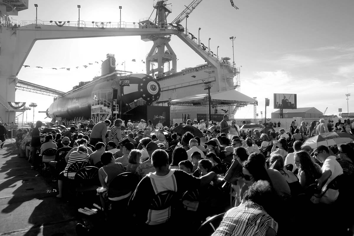 Guests find their seats prior to the christening of the submarine John Warner SSN 785 Saturday evening at Newport News Shipbuilding.