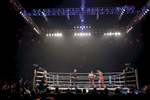 Myron Dennis, right, and Brian Collette, center, dance around the ring during Friday's SuperFight presented by Glory Sports International at the Hampton Coliseum.