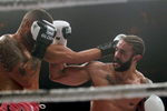Myron Dennis, left, trades punches with Brian Collette, right, during Friday's SuperFight presented by Glory Sports International at the Hampton Coliseum.