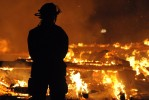 Second Place | Spot NewsBrad Coville, Wilson TimesA firefighter waits for water as a tobacco barn burns Sunday January 9, 2011 off Marton Luther King Blvd.  Three fire departments responded to the blaze but were not able to save the building.  No word on a cause Sunday night.