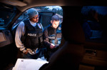 Second Place | Photo StoryAndrew Craft, Fayetteville ObserverWill Britton and Brandon Taylor look over information on Todd Lanford after looking for him at his parents home in Stedman during the Urban Shield operation. Lanford is charged with abusing and attempting to sever the genitalia of a child in 2008.