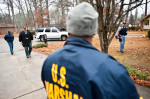 Second Place | Photo StoryAndrew Craft, Fayetteville ObserverU.S. Marshals arrive at a home in search of Bernard Jones during operation Urban Shield. Jones is wanted for felony conversion.