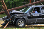 Third Place | Spot NewsDavie HinshawCharlotte ObserverThis physician fell asleep on his way home and slammed his truck into a utility pole. Firefighters kept him inside until a crew arrived.  dhobs Wrecked Doctor