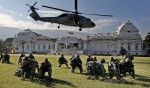 Second Place | News Picture StoryChuck LiddyNews and Observer Members of the 82nd Airborne are dropped onto the lawn of the demolished Haitian presidential palace as part of the relief effort after the earthquake.