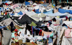 Second Place | News Picture StoryChuck LiddyNews and Observer Makeshift refugee camps springing up around Port-au-Prince are fast becoming giant petri dishes for disease and health officials fear an epidemic could soon break out.