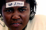 Second Place | News Picture StoryChuck LiddyNews and Observer A new victim of the earthquake has a patient number taped to her forehead as she awaits triage in Port Au Prince after a 6.1 earthquake Tuesday morning around 6:15 pm.