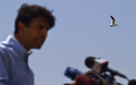 HM | News Picture Story Jessey DearingUNC Chapel HillLouisiana Governor Bobby Jindal speaks at a press conference after flying over local waters to discuss what he saw as the oil slick was approaching Louisiana's coast in May. Gov. Jindal has been extremely vocal, even helping clean some of the oil himself, calling for more help from the government and an end the Obama administration's drilling moratorium. Despite the continuing threats to his state's citizen's, Jindal as also dropped out of the limelight in local and national media coverage.