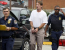 Third Place | News Picture StoryShawn RoccoNews and Observer He was told stress may have caused the rupture. Here he's escorted by correctional officers into the Duke Eye Center in Durham to undergo tests that could not be performed in prison.