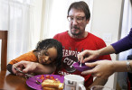 Third Place | News Picture StoryShawn RoccoNews and Observer Taylor's daughter Kristen Puryear gives him the last piece of bacon as he shares breakfast with his grandson Charles Puryear Jr., 23 months, in Kristen's kitchen the day after his exoneration.
