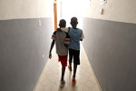 Second Place | Feature Picture StoryEthan HymanNews and ObserverRooby Roubens, left, and Didley Desir walk down the hallways the Yahve-Jire Children's Foundation in Tabarre, Haiti Tuesday May 4, 2010.  The orphanage is supported by Western Boulevard Presbyterian Church.