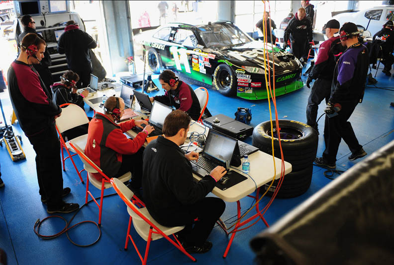 Second Place | Sports Story Jeff SinerCharlotte ObserverCrew members analyze data for the spoiler that replaced the wing in the NASCAR Sprint Cup Series.