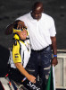 Second Place | Sports Story Jeff SinerCharlotte ObserverA NASCAR Sprint Cup Series official beams like a child as basketball legend Michael Jordan palms his head like a basketball prior to dropping the green flag.