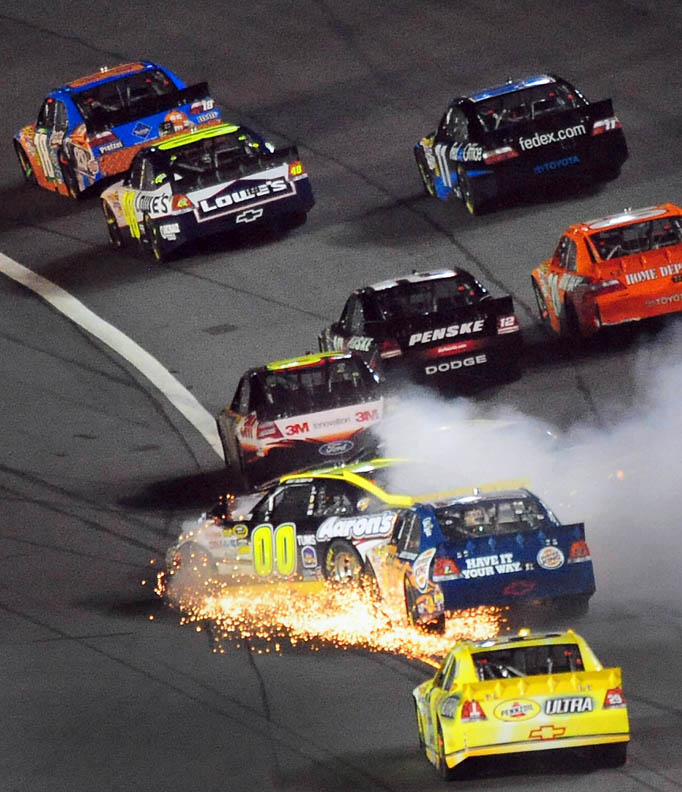 Second Place | Sports Story Jeff SinerCharlotte ObserverNASCAR Sprint Cup Series driver (00) David Reutimann kicks up sparks as he and (5) Mark Martin collide going into Turn 1.
