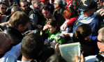 Second Place | Sports Story Jeff SinerCharlotte ObserverSurrounded by media and fans, NASCAR Nationwide Series driver Danica Patrick tries to make her way to her transporter while answering questions following an accident.