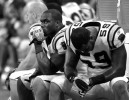 Third Place | Sports Story Jeff SinerCharlotte Observer(L-R) Carolina Panthers linebacker Jon Beason and linebacker Nic Harris sit on the team's sideline refecting the team's play vs the Rams.