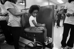 NC Photographer of the YearShawn RoccoNews & ObserverLatalya Cummings, 5, gets ready for a free haircut and styling at Tiffany's Beauty Gestures in Raleigh. Tiffany's teamed up with Paul's Barber Shop next door to give away haircuts, lunch, and some school supplies to underprivileged kids who were starting school the next day.