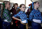 NC Photographer of the YearShawn RoccoNews & ObserverClaire Sutton, 7, center, and her line-dance team wait their turn to take the stage during the Folk Festival.