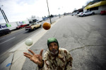 Second Place | FeaturesJames Robinson, Fayetteville ObserverVincent Owens juggles at the corner of Person and Eastern Streets Friday afternoon.