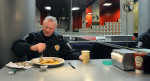 First Place | Photo StoryJohn Simmons, The Charlotte Observer(02.11.11)  CMPD Officer Charlie Walker eats a breakfast of french toast and coffee at Showmars Friday morning  on his last day in uniform before he retires from the force.