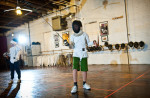 Third Place | Photo StoryAndrew Craft, Fayetteville ObserverBaker White takes his stance as he prepares to fence with another student during class at All-American Fencing Academy in Fayetteville.