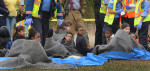 Second Place, Spot NewsTodd Sumlin, The Charlotte Observer3/9/2011 Students huddle together in blankets in a triage area after two school buses collided on Neal Rd. Thursday afternoon.
