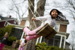 First Place, FeatureJerry Wolford, News-RecordAndrea Graham, 5, swings high into the air with her on the stomach style.