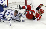 Second Place, SportsChris Seward, The News and ObserverThe Toronto Maple Leafs' James Reimer (34) loses his helmet as he gathers in the puck in front of the Carolina Hurricanes' Cory Stillman (61) during the third period of an NHL game played between the Carolina Hurricanes and the Toronto Maple Leafs at the RBC Center in Raleigh on  March 16, 2011.   The Leafs beat the Canes 3-1.
