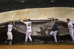 Third Place, SportsJerry Wolford, News-RecordThe UNCG baseball team laugh as they cover the field with a tarp during a rain storm with high winds.