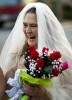 First Place, Photo StoryJerry Wolford, News-RecordCarolyn McHenry, chewing gum to calm her nerves, laughs after arriving for her wedding.