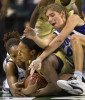 Second Place, Photo StoryJerry Wolford, News-RecordDuke's Karima Christmas (left) and teammate Allison Vernerey fight for a loose ball with GT's Sasha Goodlett (center).