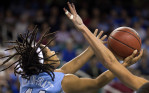 Second Place, Photo StoryJerry Wolford, News-RecordUNC's Tierra Ruffin-Pratt's reaches for a rebound.