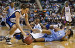 Second Place, Photo StoryJerry Wolford, News-RecordDuke's Haley Peters (left), Karima Christmas (center) and North Carolina's Tierra Ruffin-Pratt, right, wrestle for control of a loose ball.