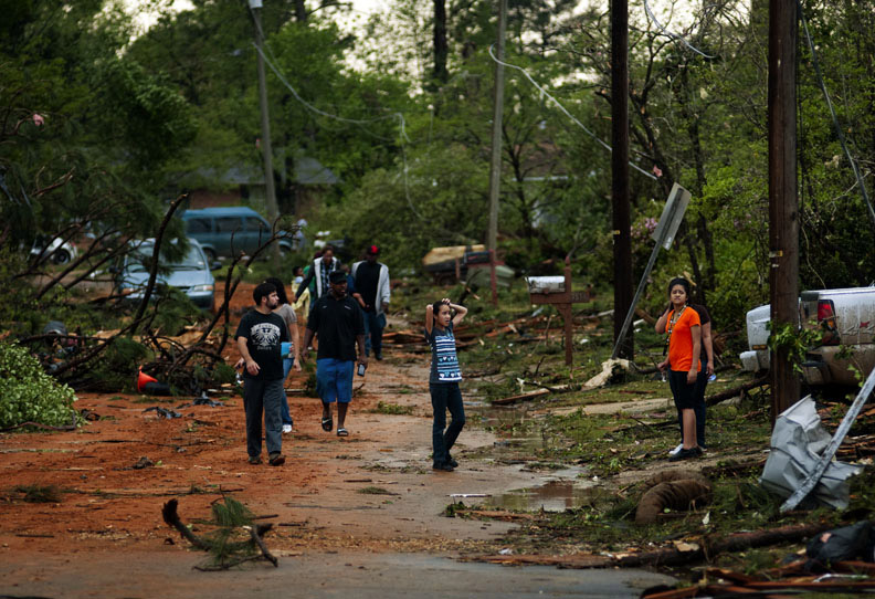 First Place | Photo StoryJames Robinson, Fayetteville ObserverPeople evacuate there homes on Overbrook Drive homes after a Tornado passed through the LaGrange subdivision.