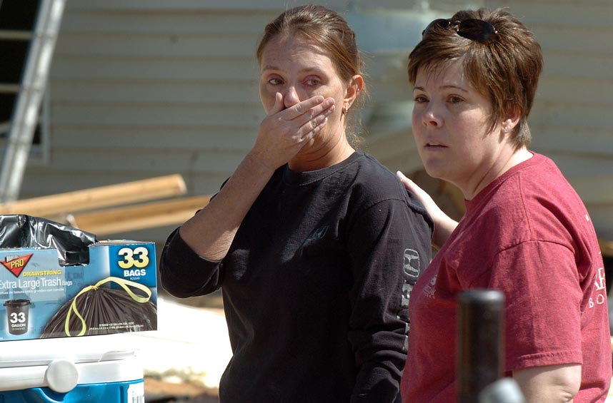 Second Place | Photo StoryBrad Coville, The Wilson TimesMelissa Webb comforts Kim Stalling on Cranberry Drive Sunday morning after a tornado tore through Wilson Saturday. Stallings' boyfriend Scott, was at home when his home was destroyed.