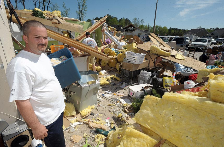 Second Place | Photo StoryBrad Coville, The Wilson TimesScott Smith Surveys the damage after his home in the Cranberry Ridge subdivision was destroyed by an EF-2 tornado Saturday April 16, 2011. Smith rode out the storm in the bathroom of his home.