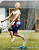 Second Place | FeatureRhett Butler, The Daily ReflectorLogan Evans, 4, beats the heat while playing in a water sprinkler that his father was using to water the grass at their home on Old Creek Road.