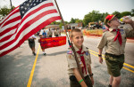 Honorable Mention | FeatureAndrew Craft, Fayetteville ObserverBoy Scouts, Krys Marshall, left, and Dylan Genova, march in the Hope Mills Fourth of July Parade.