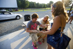 First Place | Photo StoryJames Robinson, Fayetteville ObserverFrom right, Brandon Pondo, 18, Jennifer Birch, 16, and Lissette Payne, 16, hang out at the Badin Road Drive-In before the movie Friday evening.