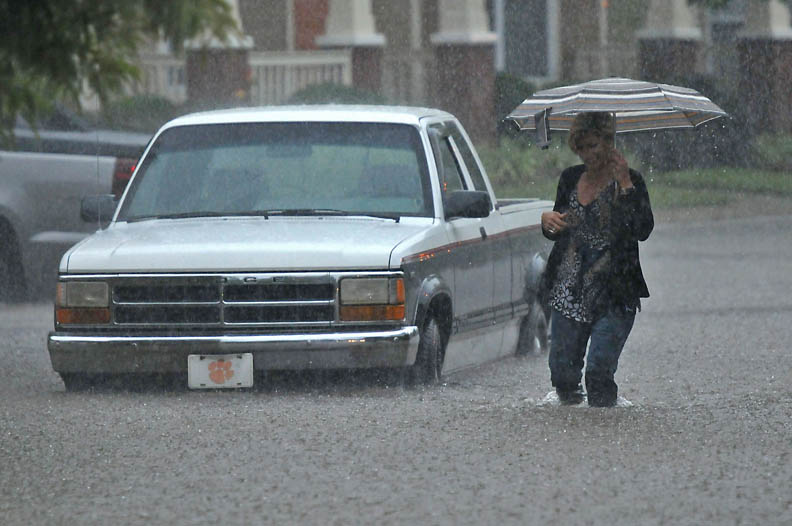Second Place | Spot NewsTodd Sumlin, The Charlotte Observer8/5/2011 A motorist abandons her stalled truck in west Charlotte Friday afternoon. Heavy rains swept across the area causing flooding to low-lying areas.