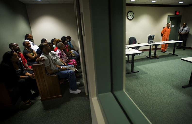 First Place | General NewsJames Robinson, Fayetteville ObserverThe family of Erica Gainey look on during the first court appearance of Terry Dale Robinson, who is charged with first-degree murder and kidnapping in the death of Erica Gainey of Fayetteville.