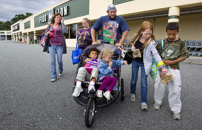 Second Place | Photo StoryJerry Wolford, News-RecordThe Tucker's make their way back to Pathways after shopping for groceries.