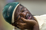 Third Place | Photo StoryJerry Wolford, News-RecordVincent Mann of WInston-Salem gets a short nap between the groups of players putting on the ninth green.
