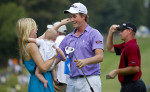 Third Place | Photo StoryJerry Wolford, News-RecordWebb Simpson embraces his wife, Dowd, (left), and son James, (center), after winning the Wyndham Championship golf tournament.