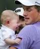 Third Place | Photo StoryJerry Wolford, News-RecordWebb Simpson holds his son James, who started crying within seconds of leaving his mother's arms, after winning the Wyndham Championship